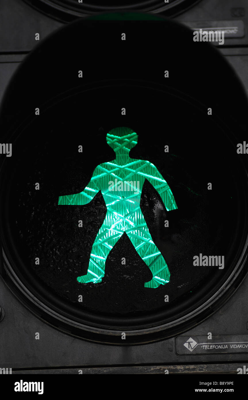 Green Pedestrian Crossing Sign Close Up - Stock Image