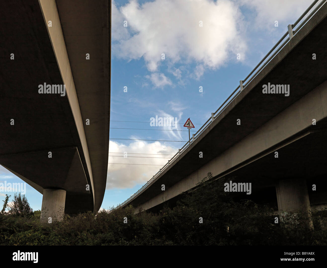 fly-over road bridges with junction sign - Stock Image