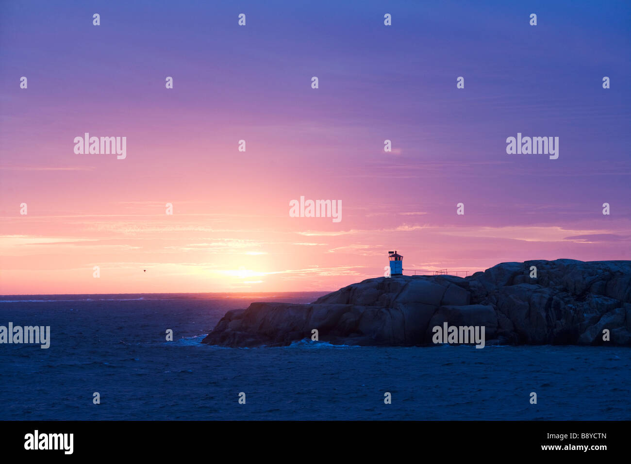 A lighthouse in sunset Smogen Bohuslan Sweden. - Stock Image