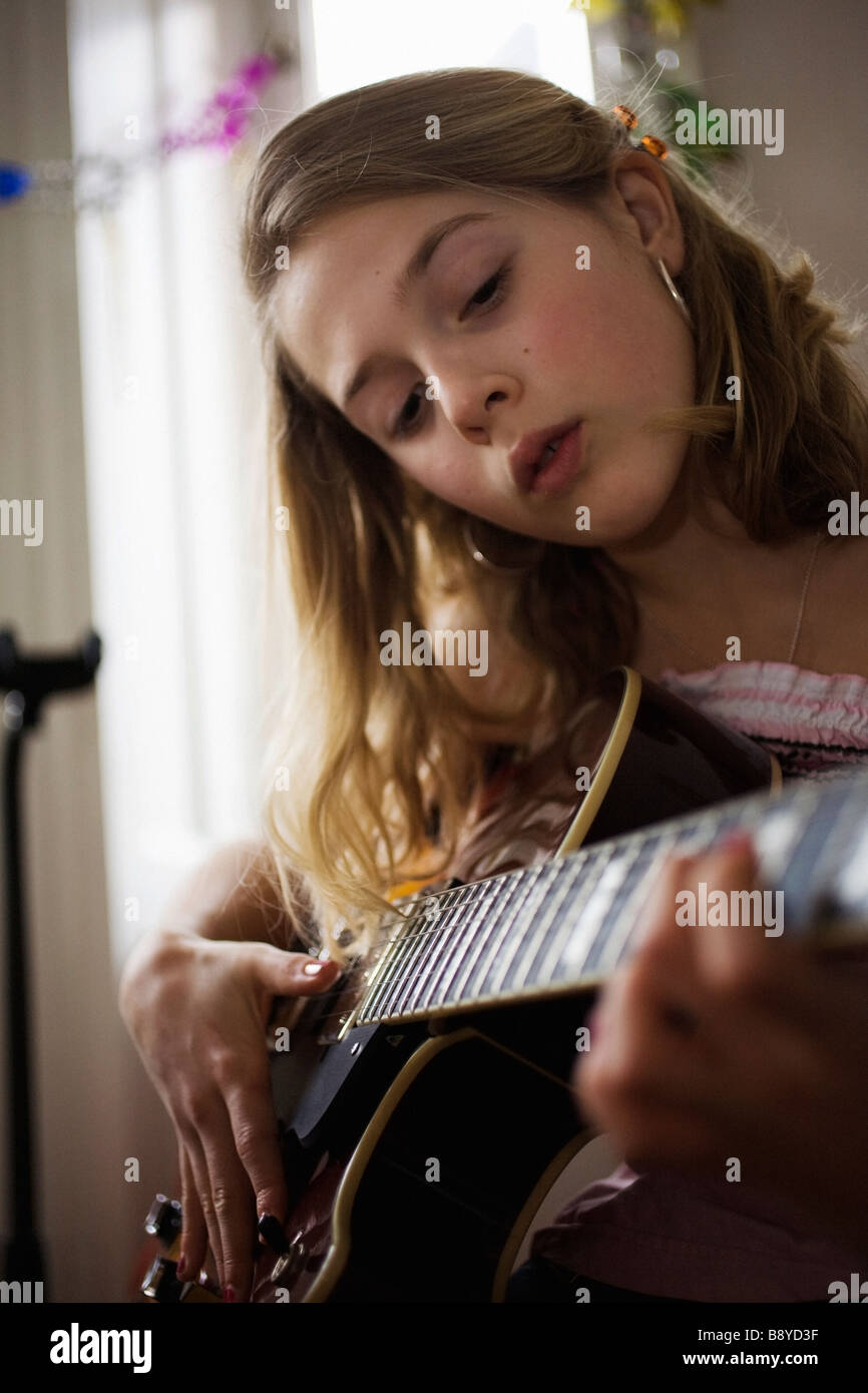 A girl playing the guitar Sweden. - Stock Image