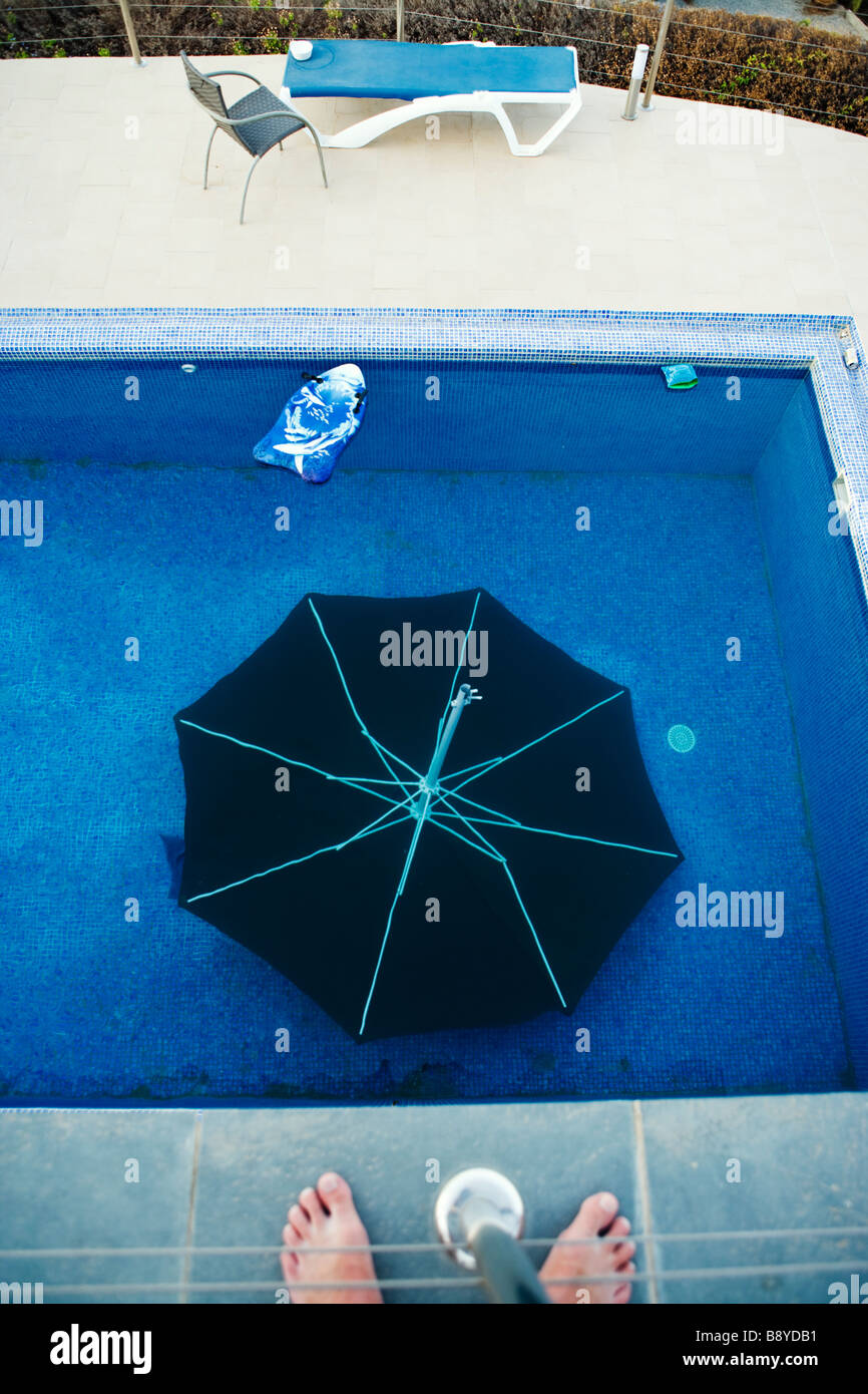 A parasol in a swimming-pool Spain. - Stock Image
