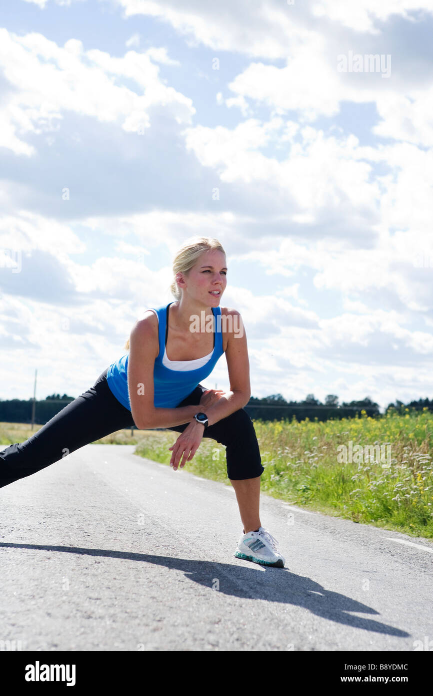 A woman doing stretching exercises Sweden. Stock Photo