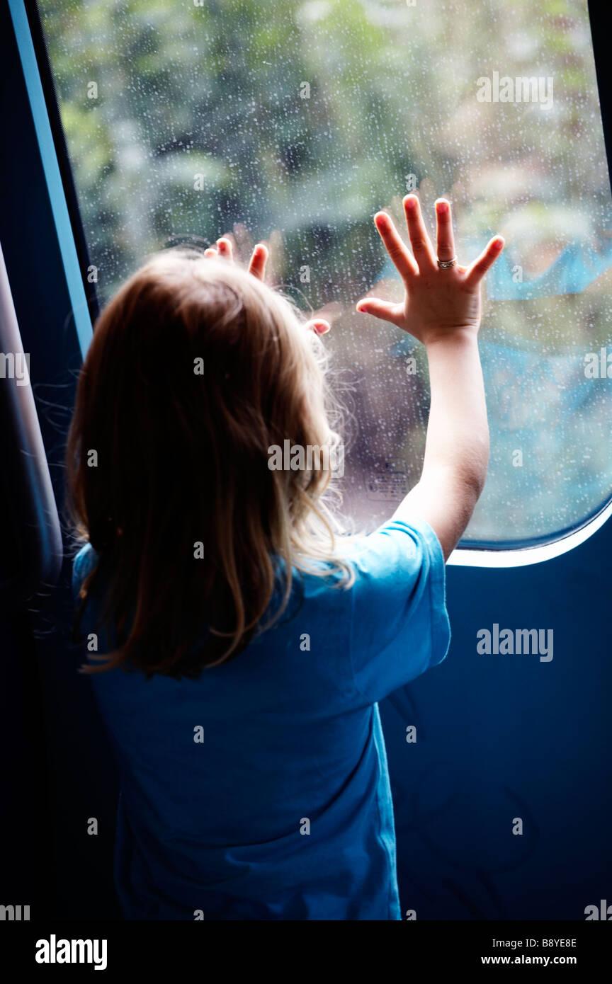 A girl on a train Copenhagen Denmark. - Stock Image
