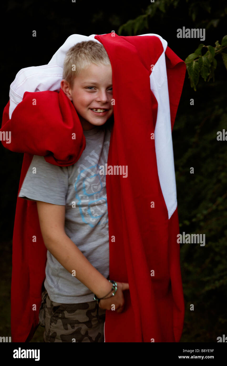 A boy and the Danish flag Denmark. - Stock Image