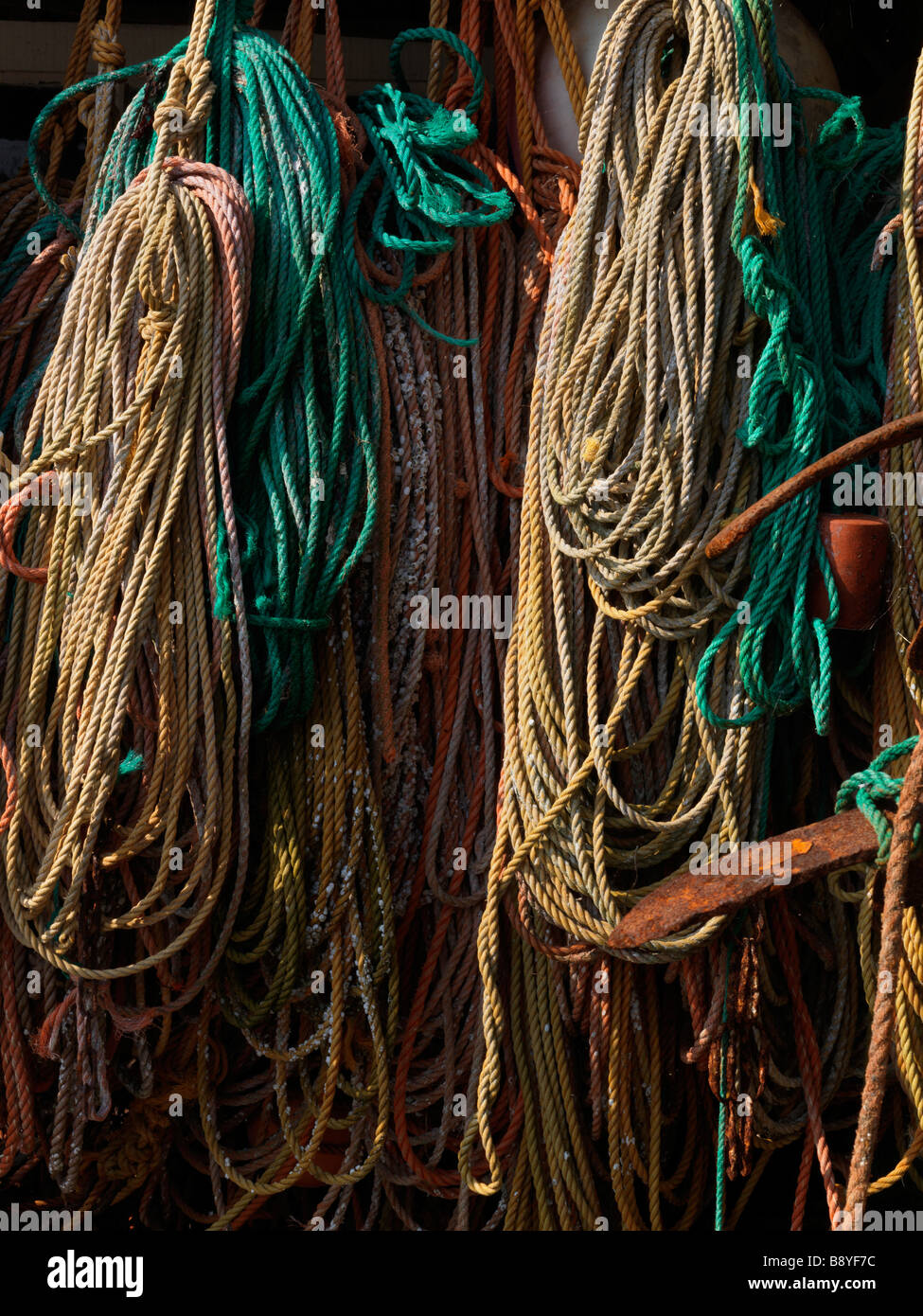 Fishing equipment hanging on a wall. - Stock Image