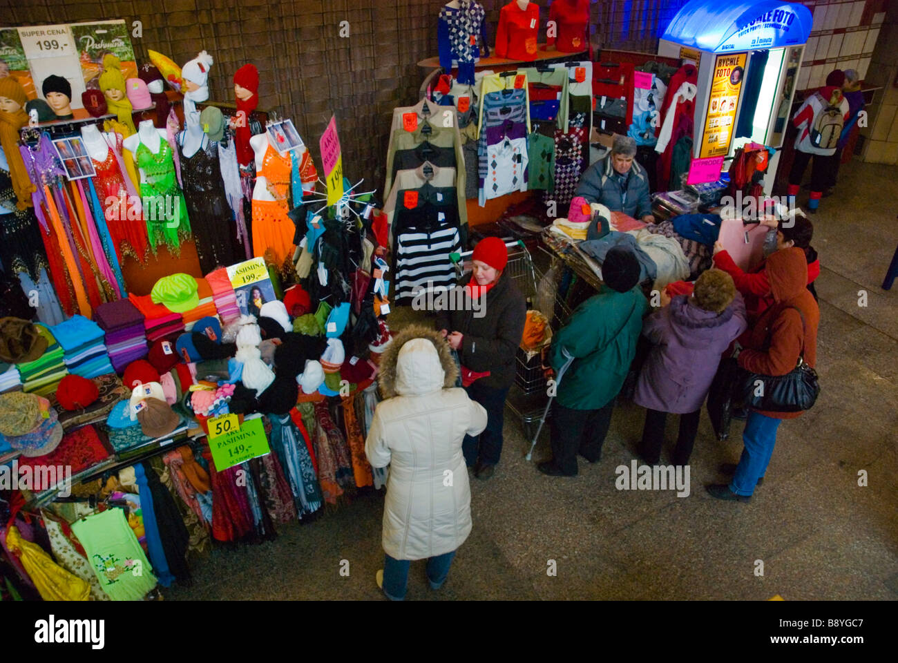 Stalls selling pashmina and other clothes and garments at Vltavska metro station in Prague Czech Republic Europe - Stock Image