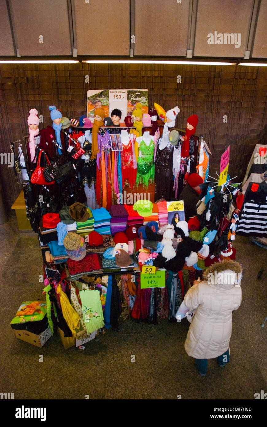 Stall selling pashmina and other clothes and garments at Vltavska metro station in Prague Czech Republic Europe - Stock Image