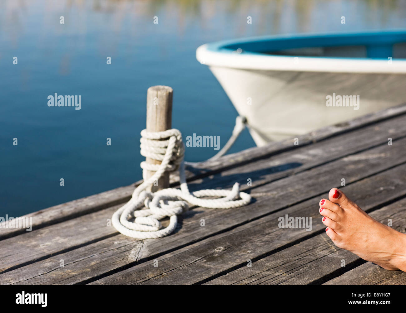 A foot on a jetty. - Stock Image