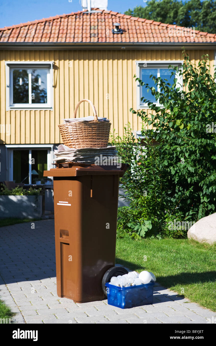 A garbage bin in a garden. - Stock Image