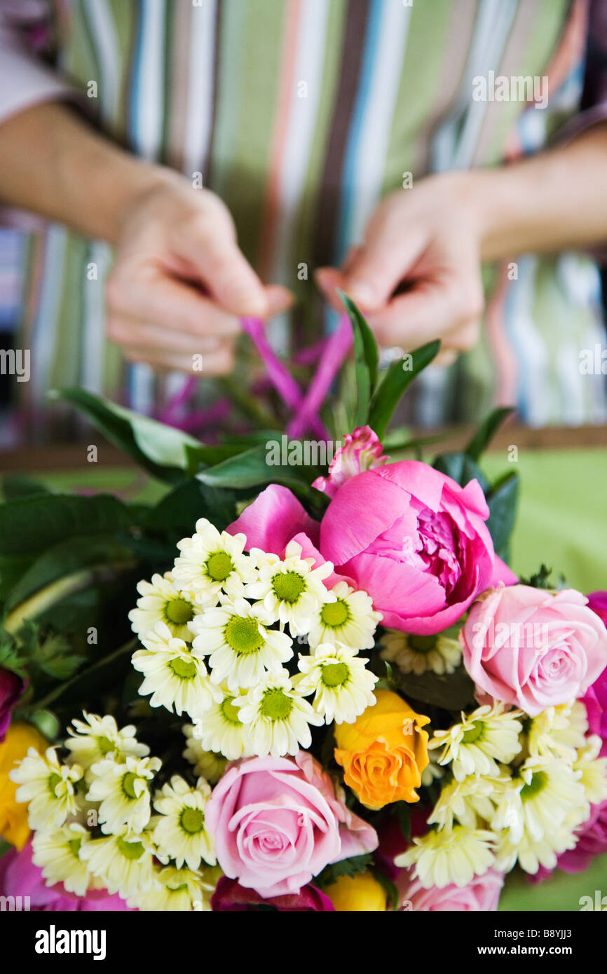The hands of a woman working in a flower shop Sweden. - Stock Image