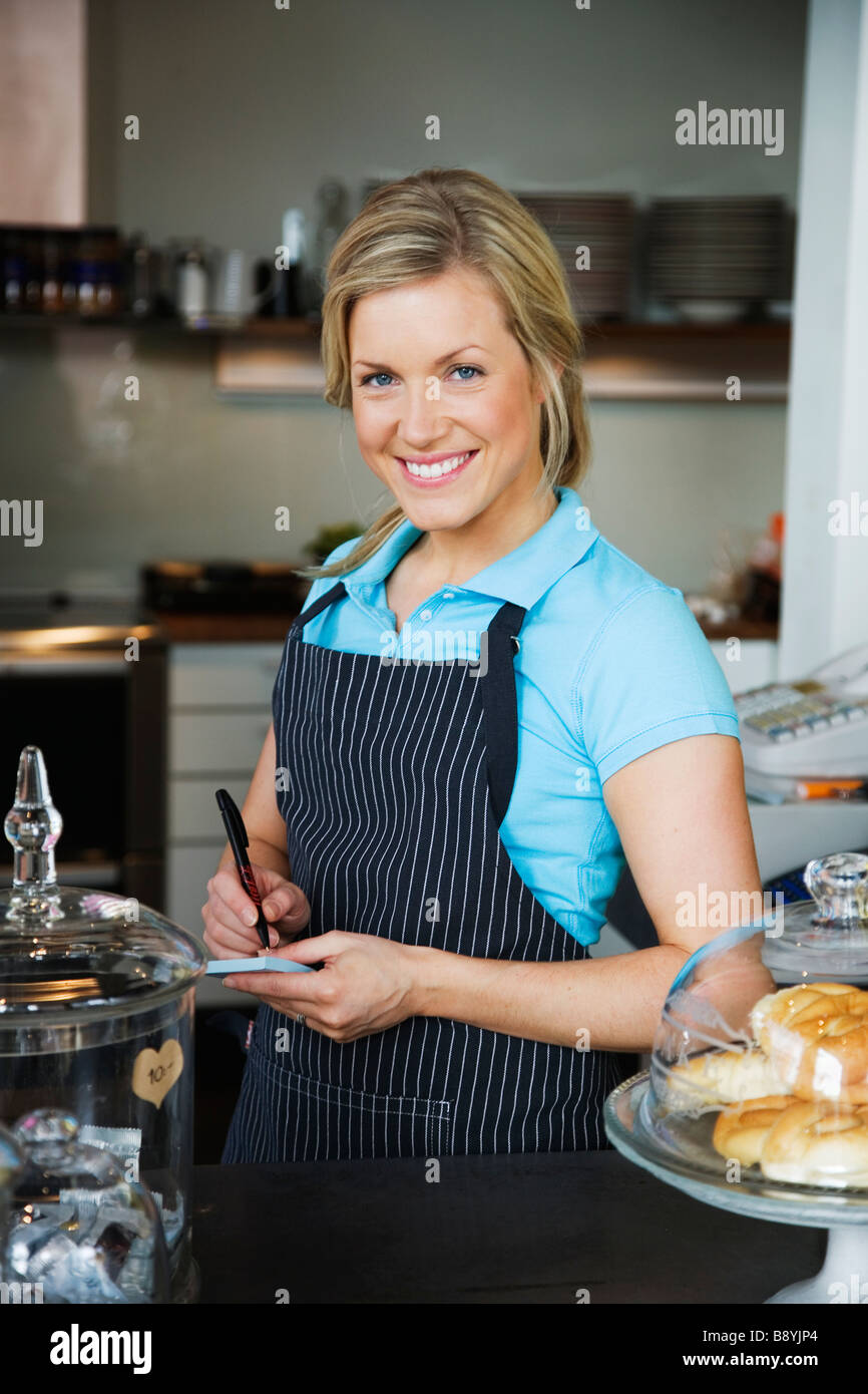 A woman working at a café Sweden. Stock Photo