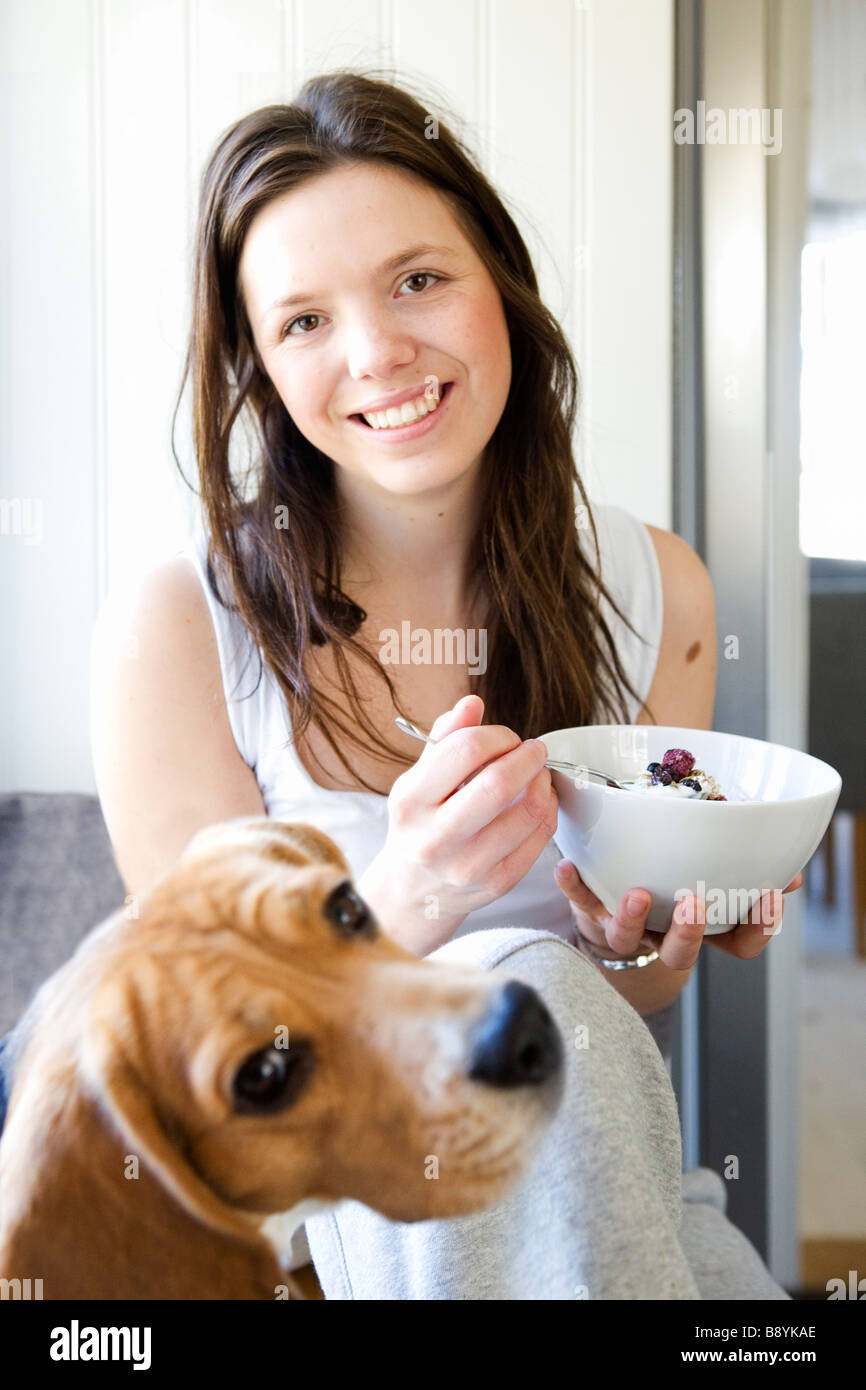 A young woman having breakfast Sweden. - Stock Image