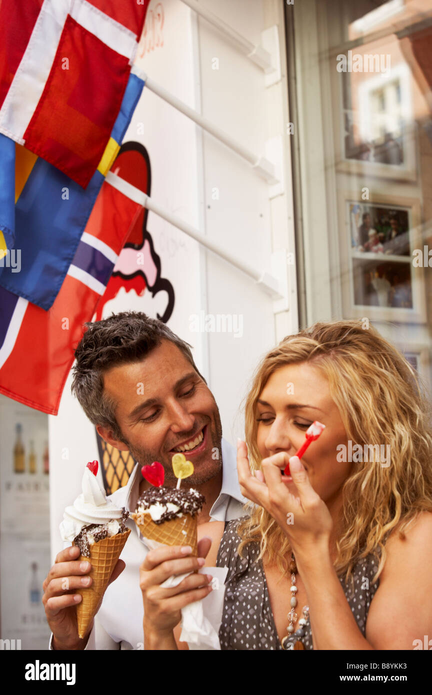 A couple having ice cream Copenhagen Denmark. - Stock Image