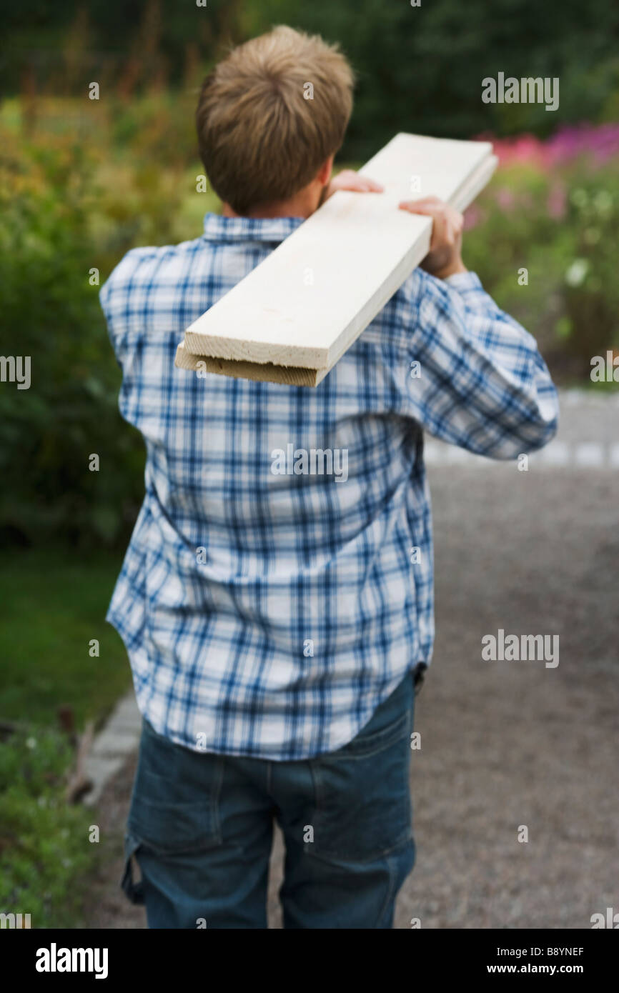 A man carrying deal Sweden. - Stock Image