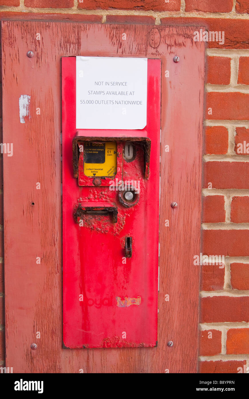 A Close Up Of An Old Postage Stamp Vending Machine With A