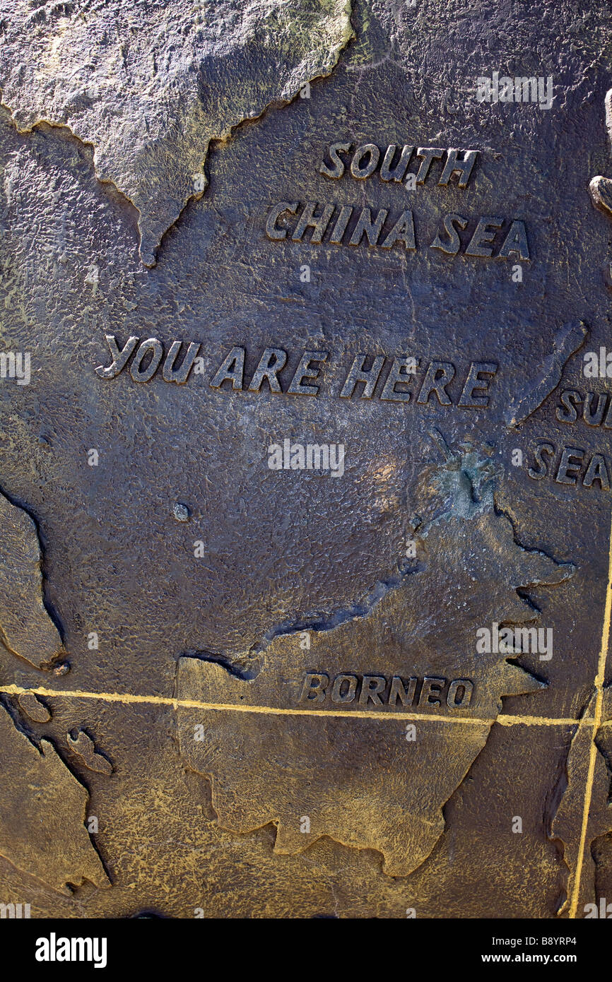 Tip of Borneo Monument Tanjung Simpang Mengayau stating 'You Are Here' with a map of Borneo showing equator - Stock Image