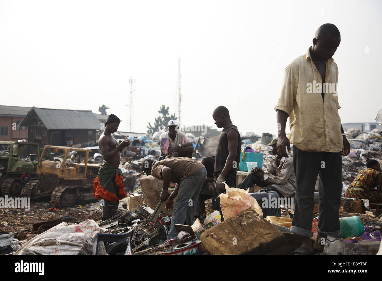 Human scavengers looking for useful rubbish on the Olusosum dump site in Lagos.  The is is one of 6 municipal sites. - Stock Image