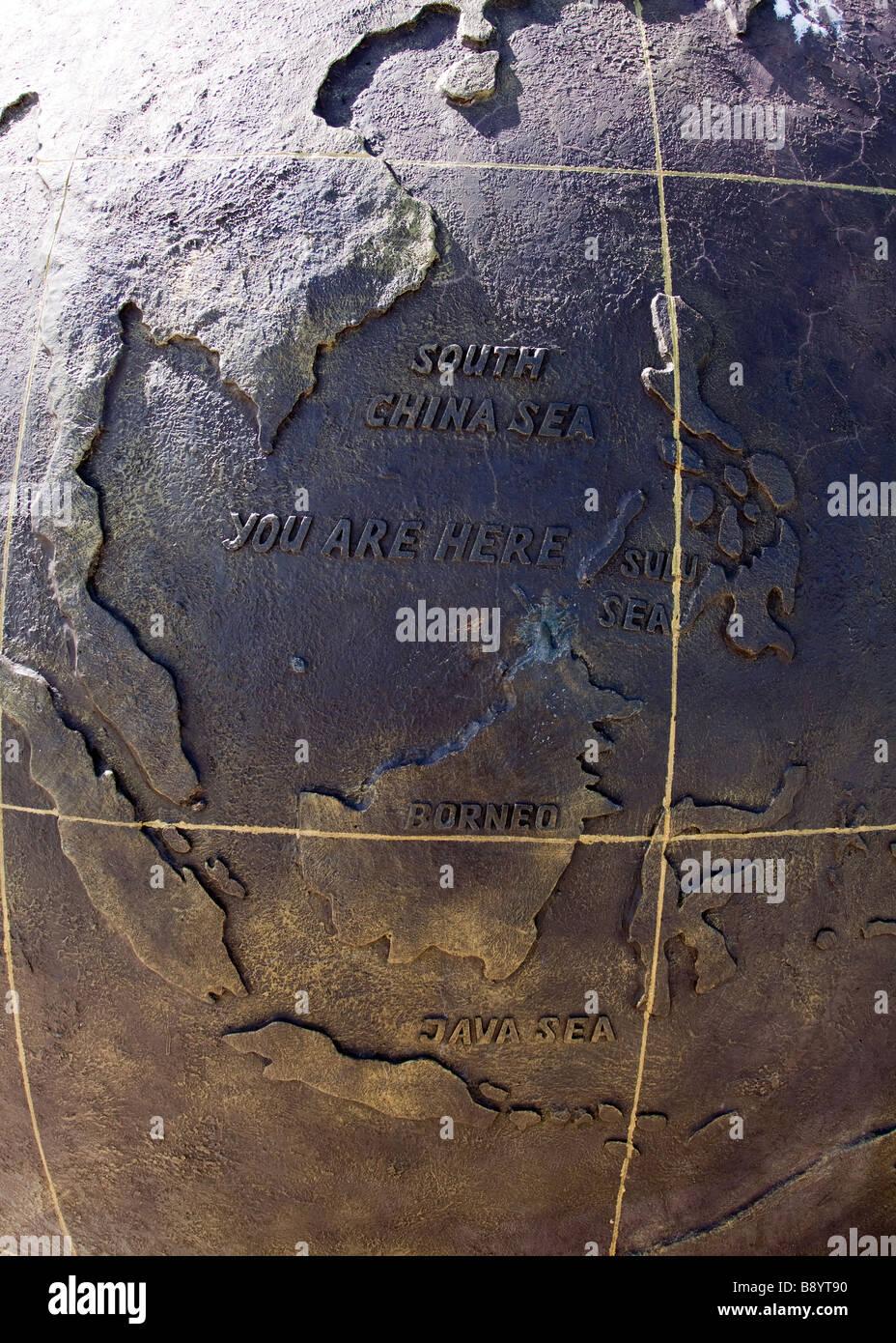 Map of Borneo stating 'You Are Here' at the Tip of Borneo Monument at Tanjung Simpang Mengayau Kudat Sabah - Stock Image