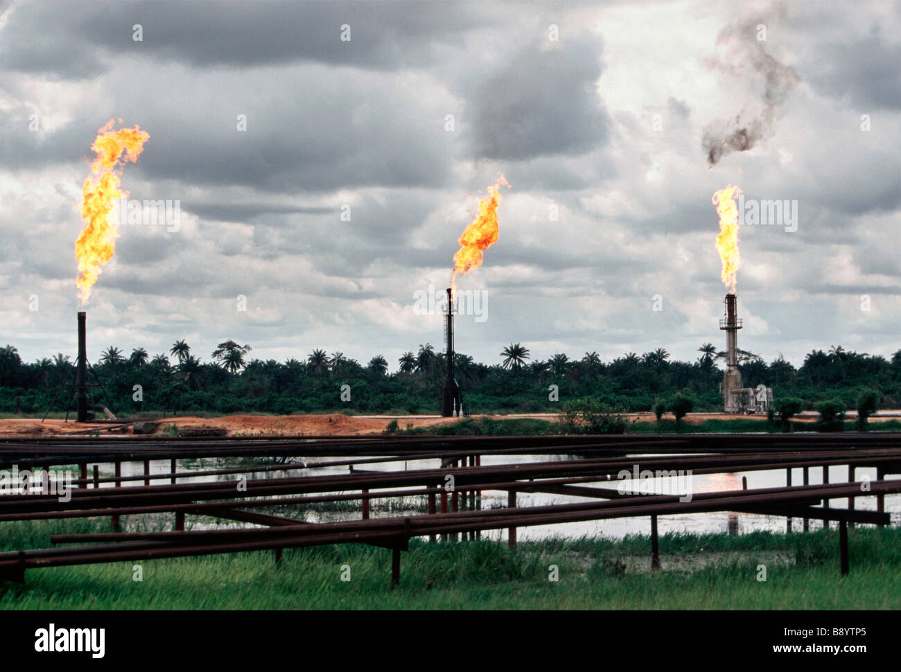 Nigeria: environmental pollution by burning off gas from the oil production in the Niger delta Ogoniland - Stock Image