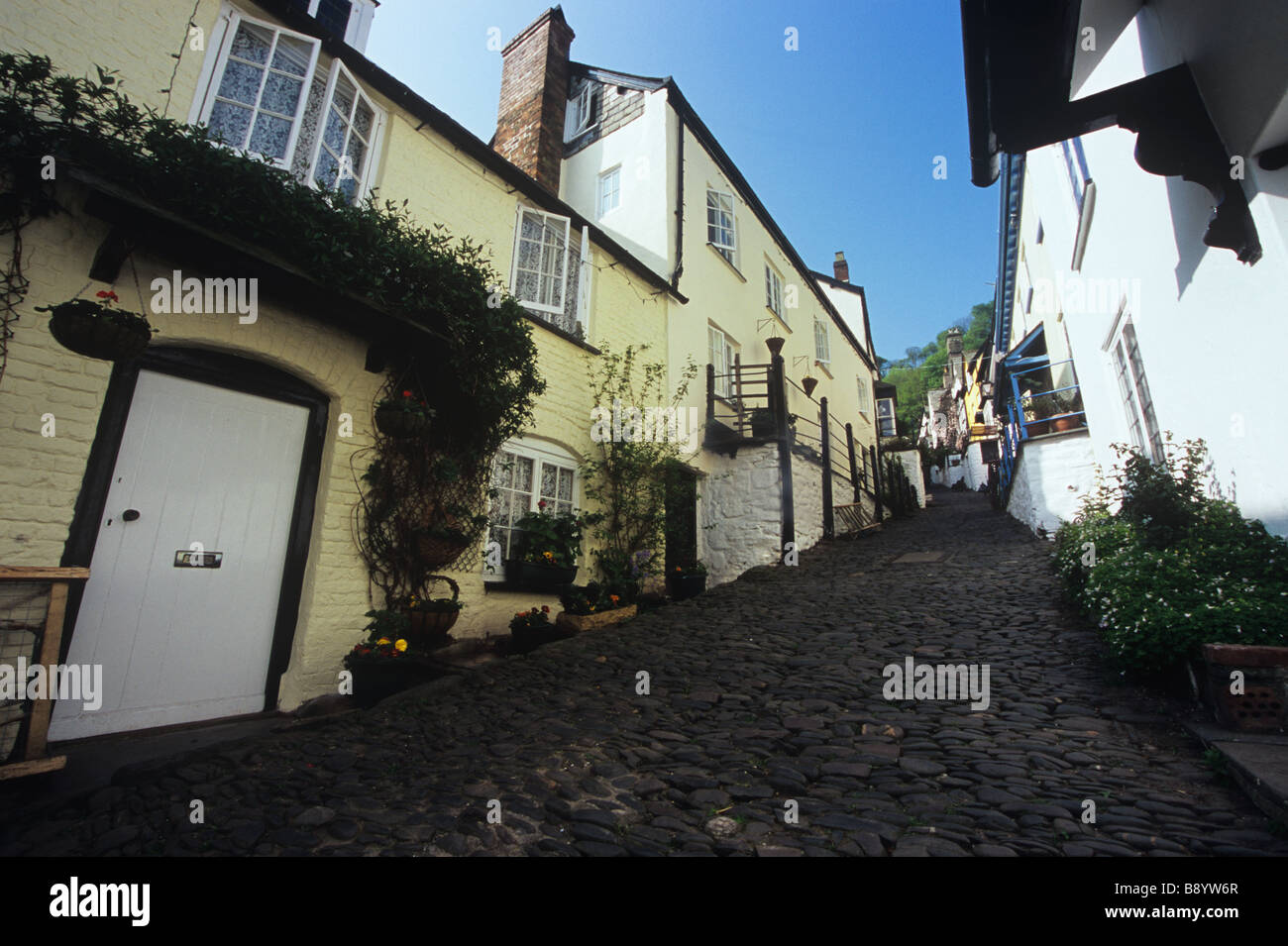 Cobbled main street and cottages on a quiet day in the picturesque  village of Clovelly, Devon, UK. - Stock Image