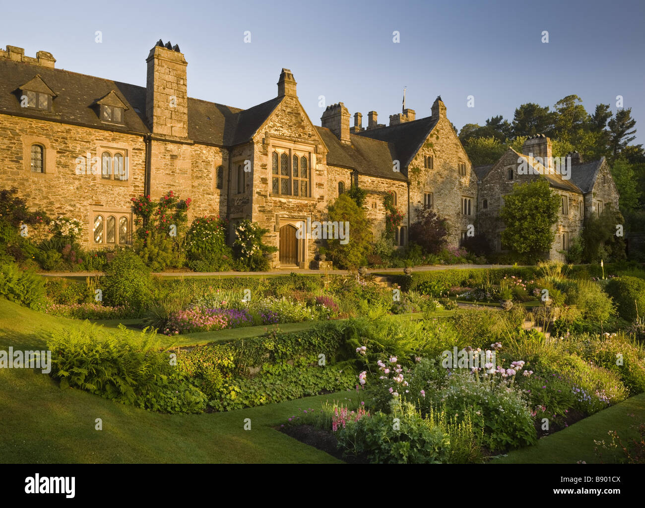 The east front of Cotehele, seen over the East Terrace garden, near ...