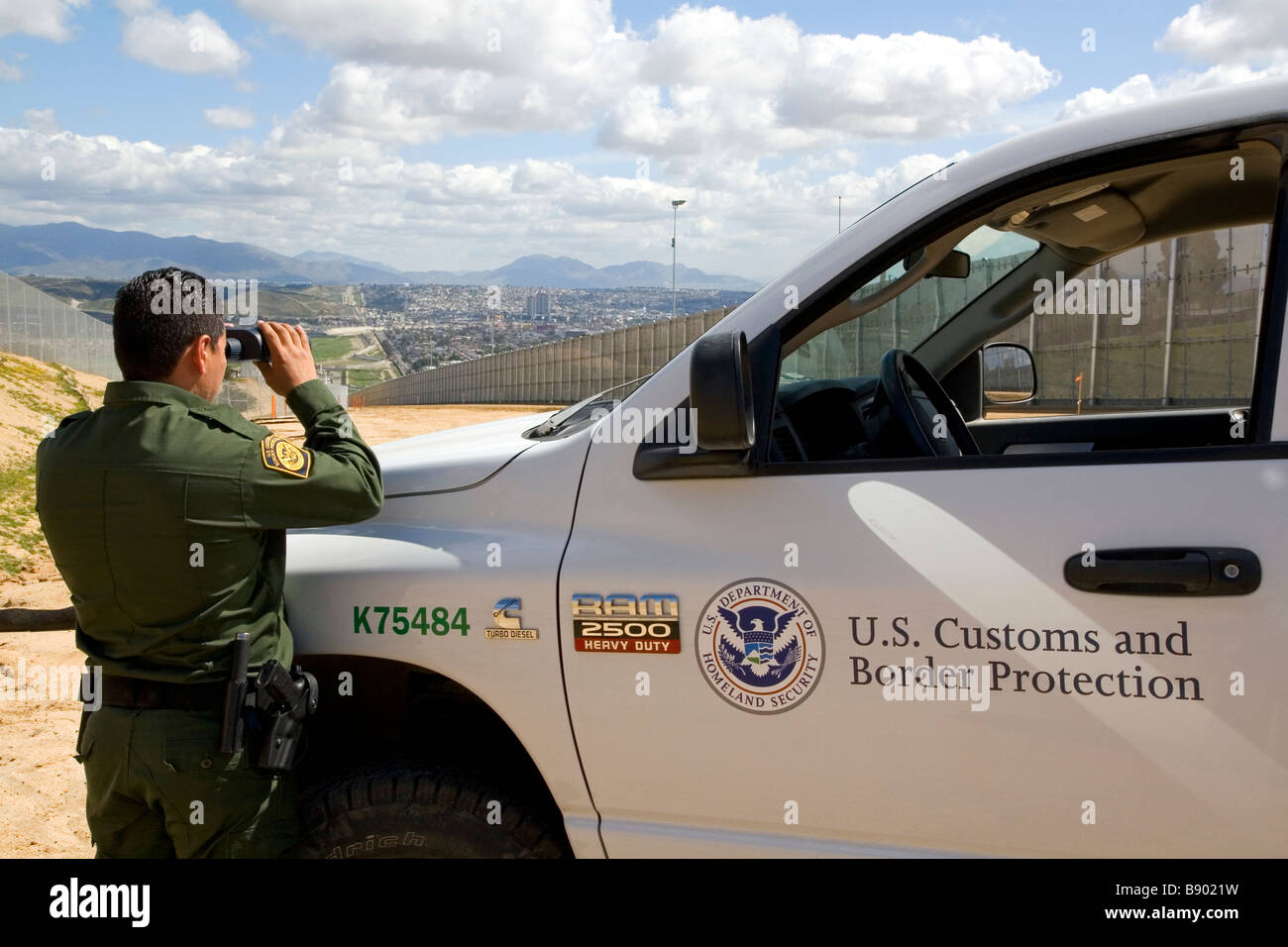 United States Border Patrol agent at the U S Mexico border near San Diego California Stock Photo