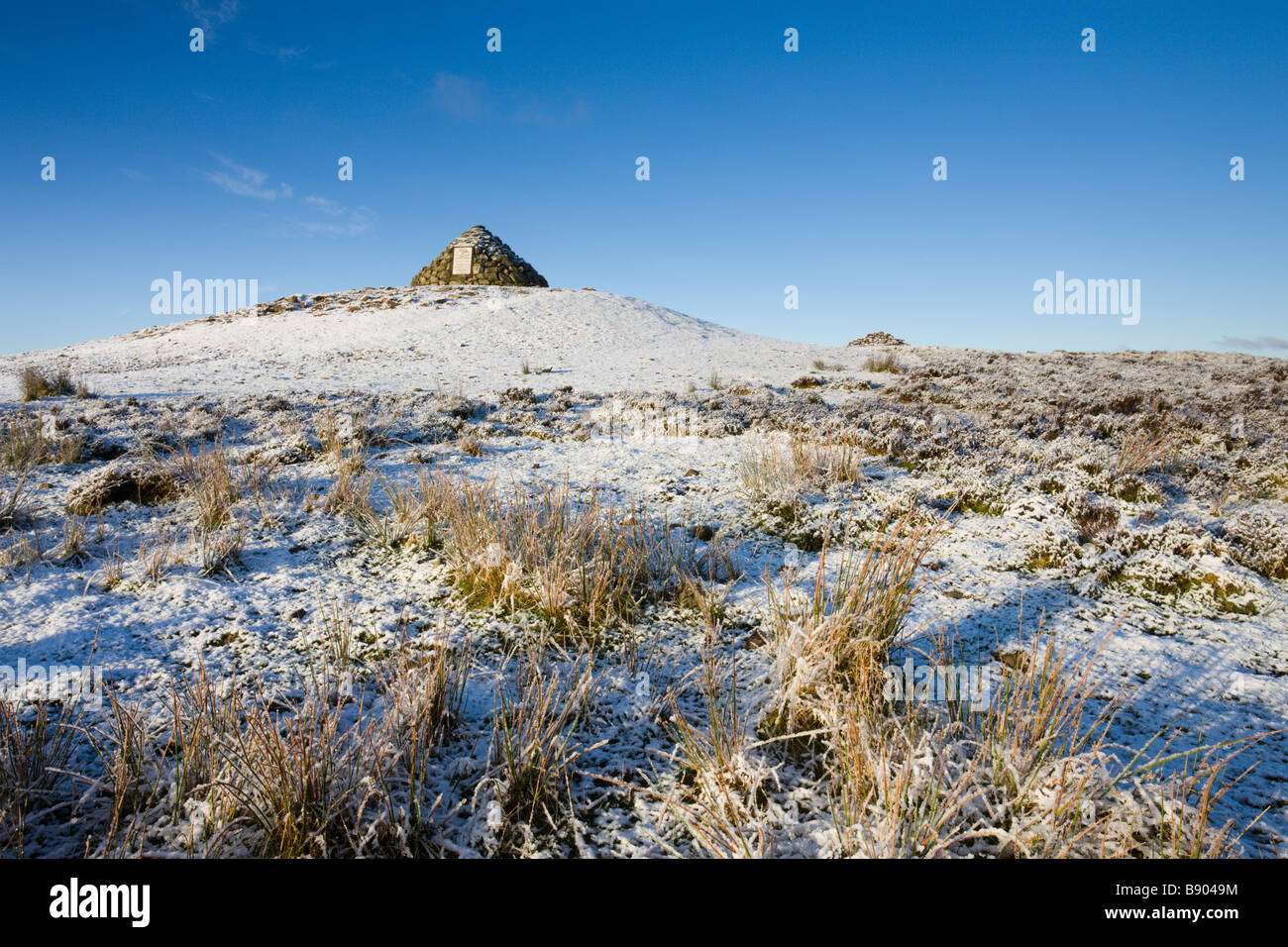 Stone Cairn at Dunkery Beacon on a snowy winter morning Exmoor National Park Somerset England - Stock Image