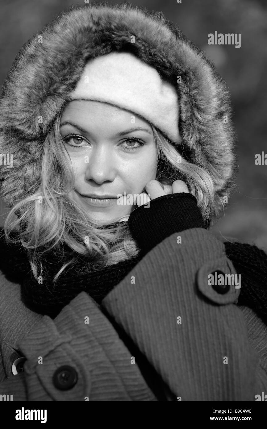 Beautiful Woman keeping herself warm. - Stock Image
