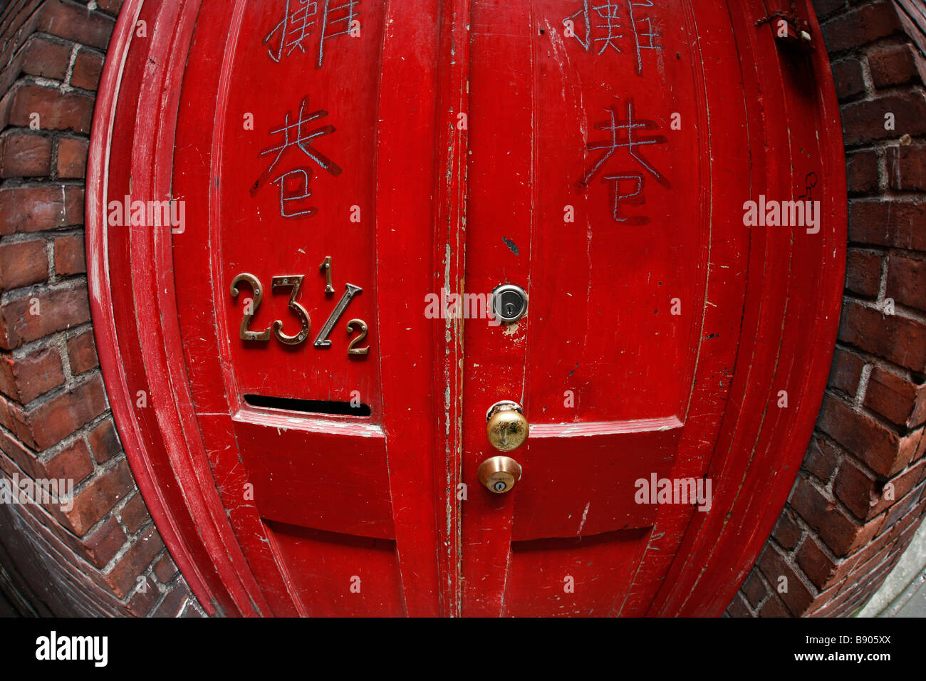 A door with an interesting address in Fan Tan Alley in Victoria's Chinatown in British Columbia, Canada. Stock Photo