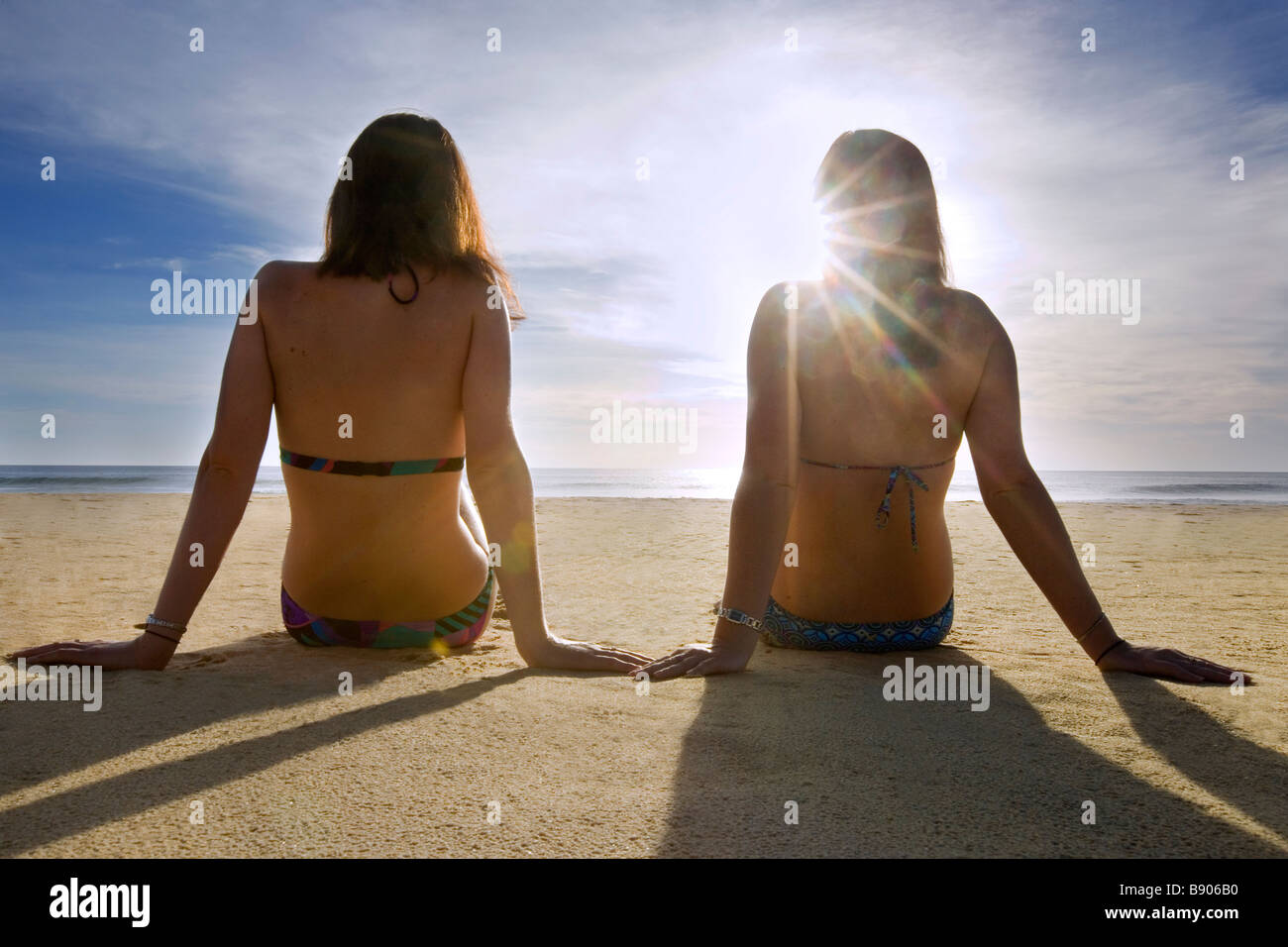 Two girls on the beach - Stock Image