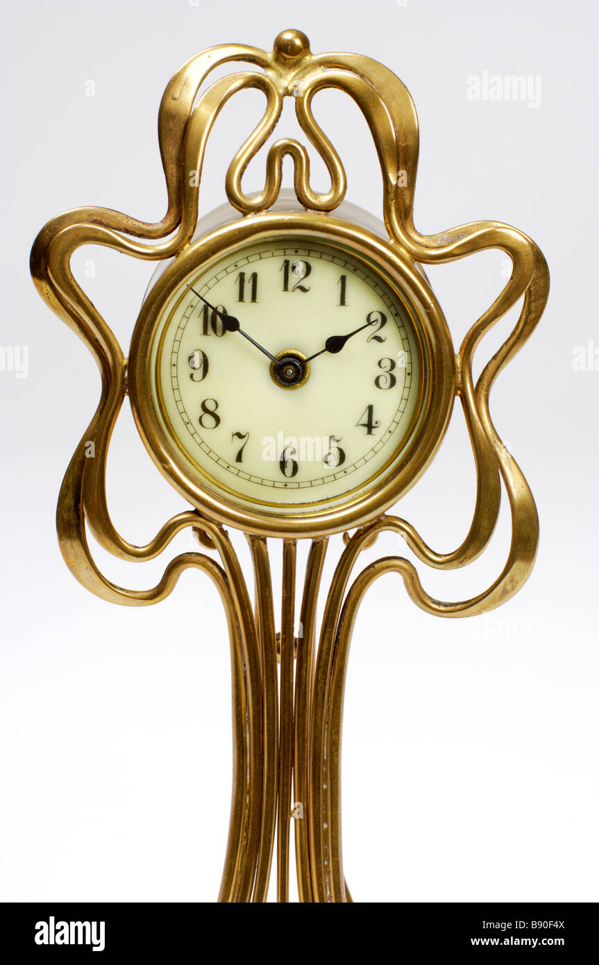 A French art nouveau table clock with brass case and enamelled dial. Circa 1900. - Stock Image