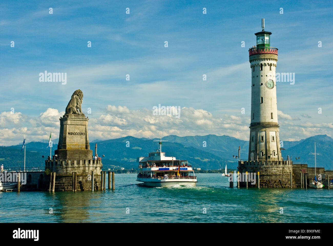 Lindau harbor entrance looking at swiss alp panorama Lake Constance Germany | Passagierschiff in der Hafeneinfahrt Stock Photo