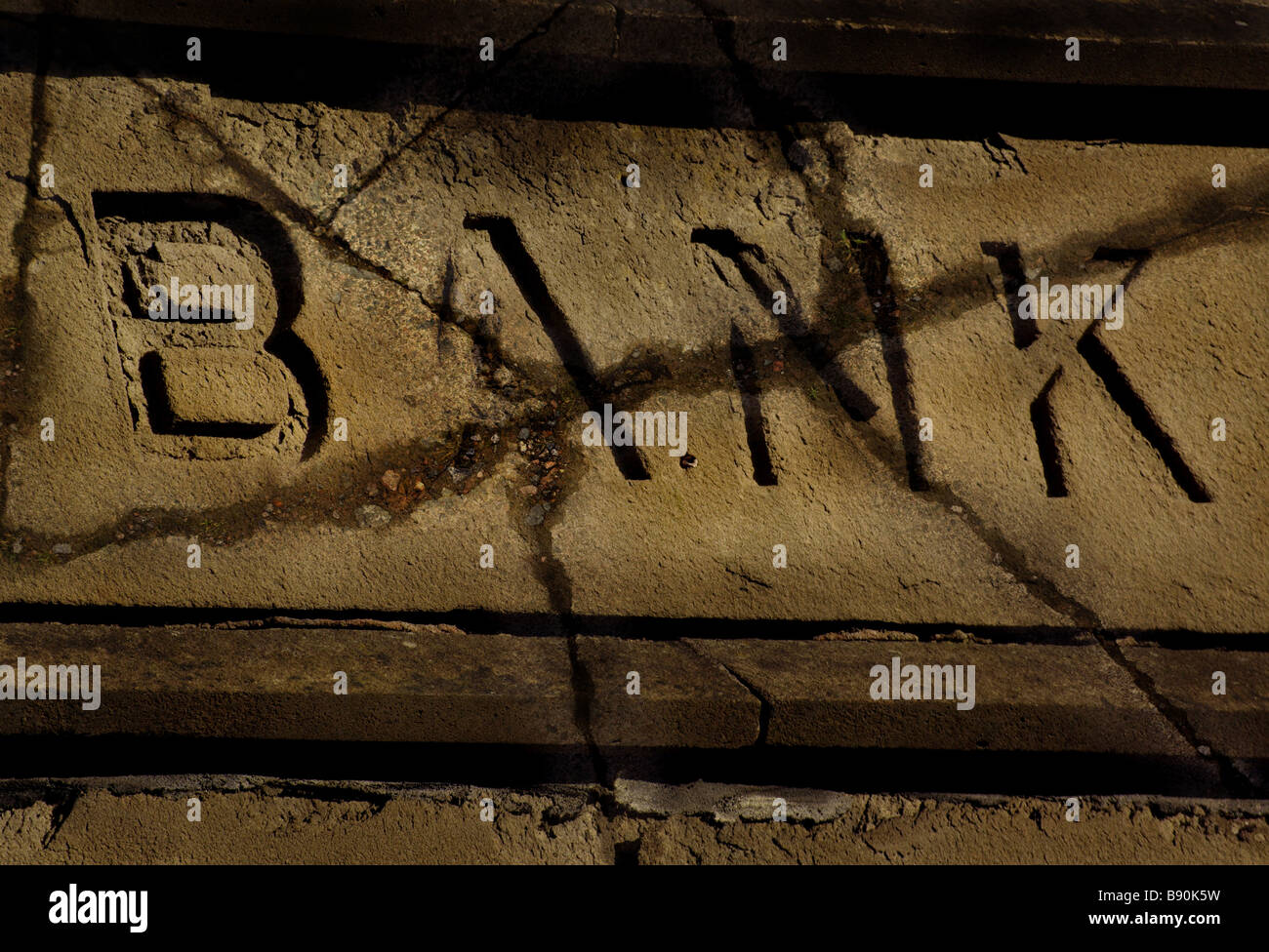 Generic Stone Bank Sign Showing Cracks and Decay due to age (Concept). Irish banking crisis - Stock Image