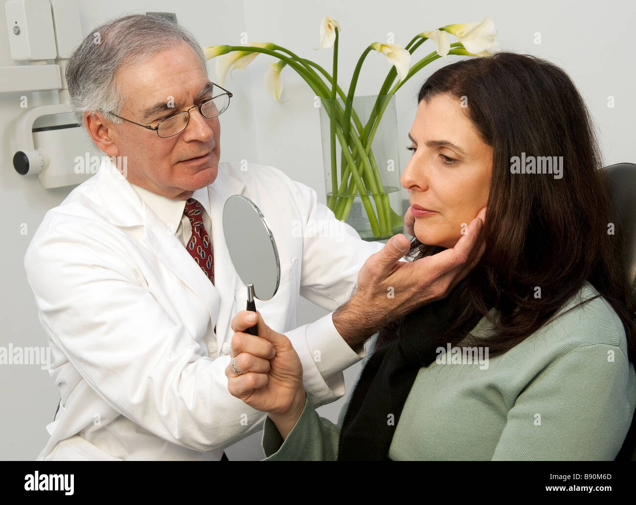 Cosmetic surgery consultation with patient. - Stock Image