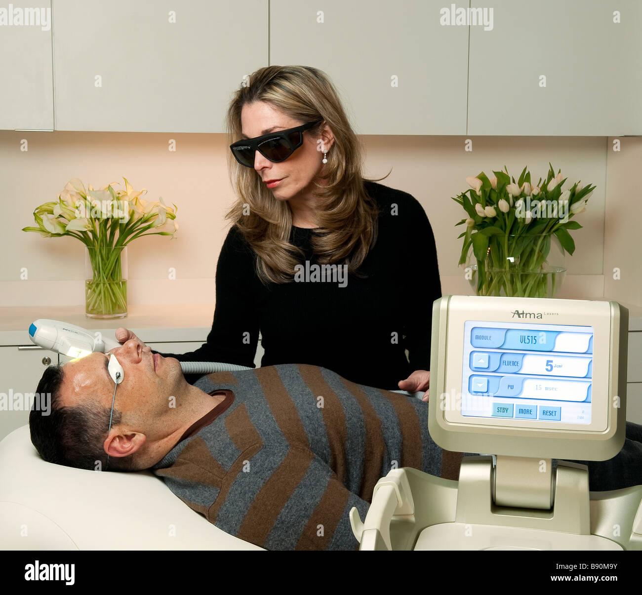 IPL Intense Pulsed Laser Treatment for damaged skin - Stock Image