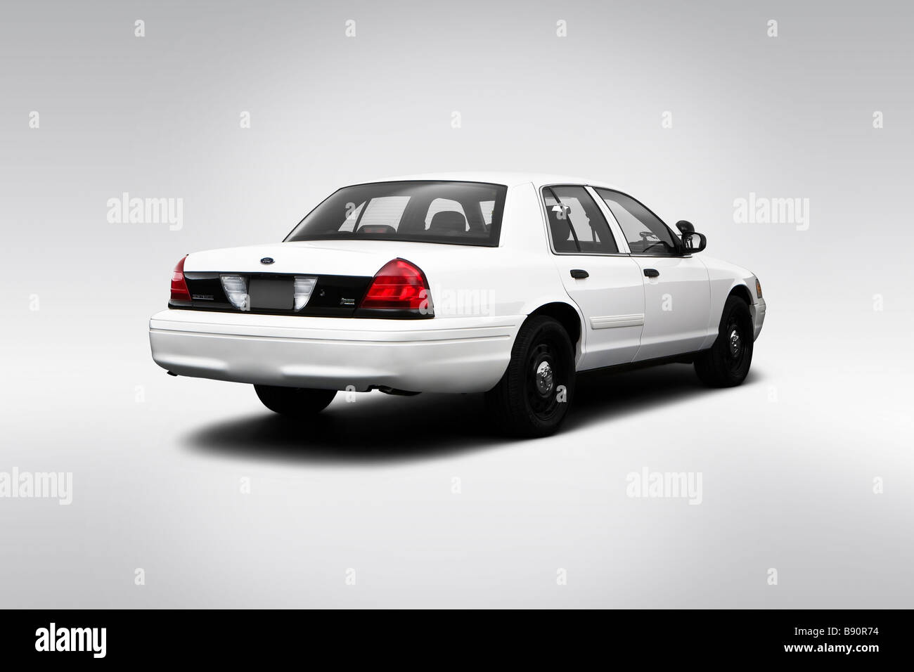 Ford Crown Victoria Police Interceptor In White Rear Angle View Stock Image