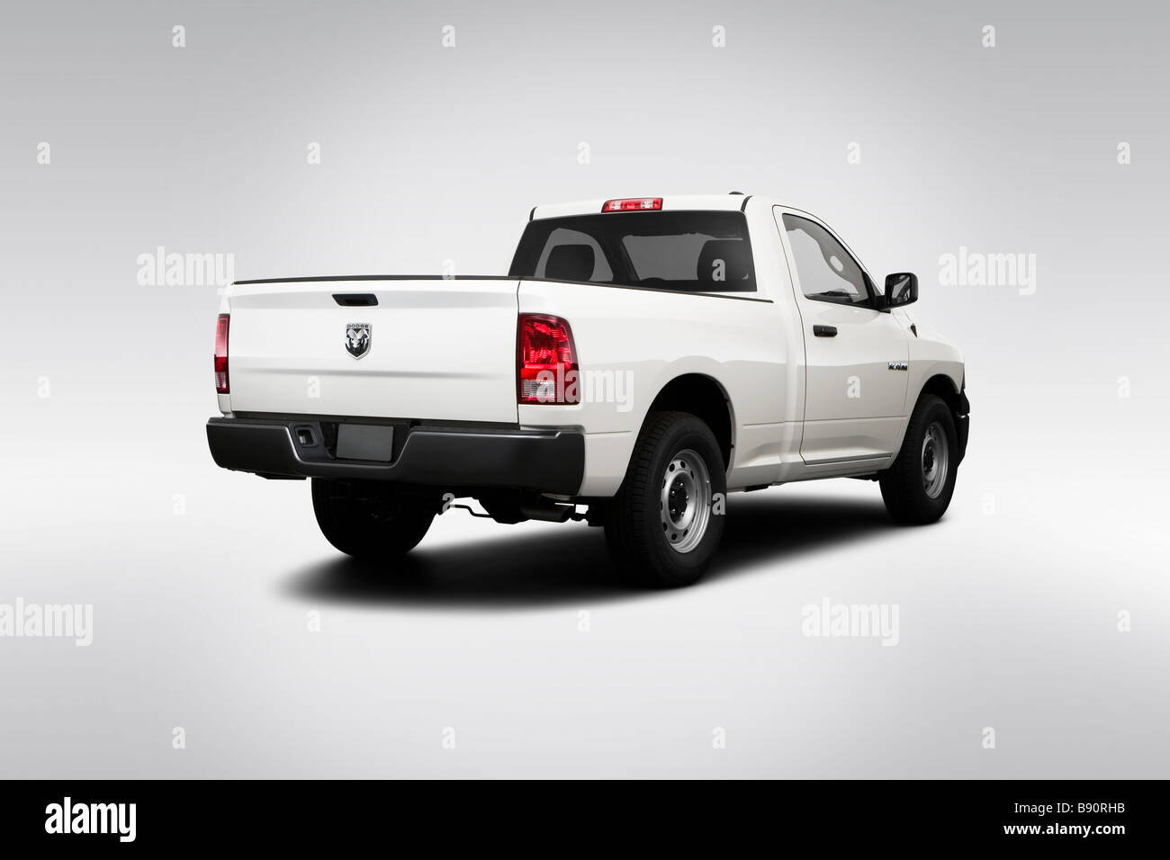 2009 Dodge Ram 1500 ST in White - Rear angle view - Stock Image