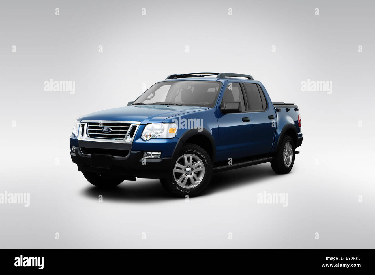 2009 ford explorer sport trac xlt in blue front angle view
