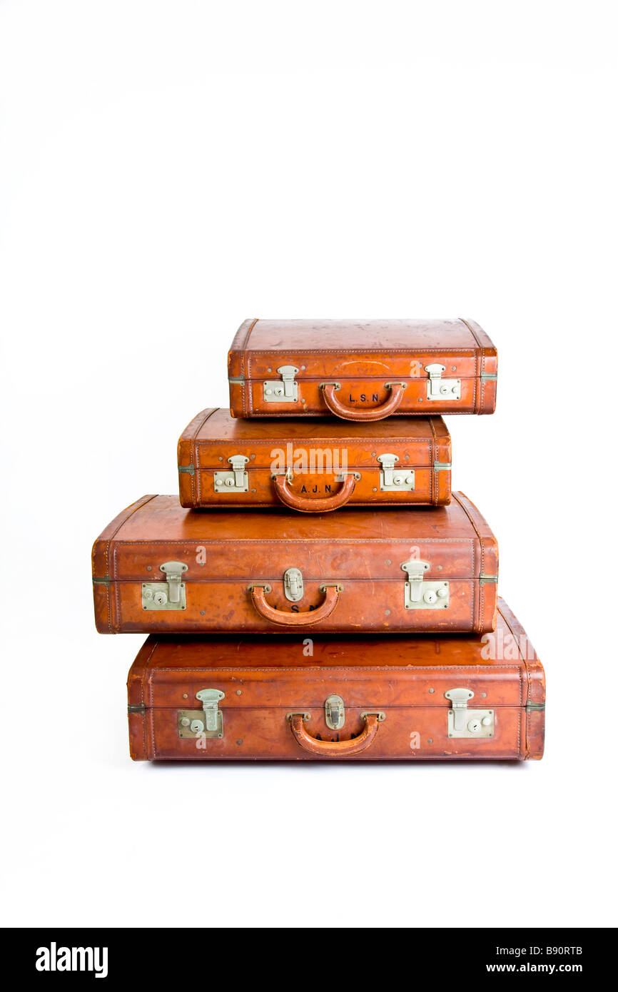 Four traditional leather suitcases on top of one another - Stock Image