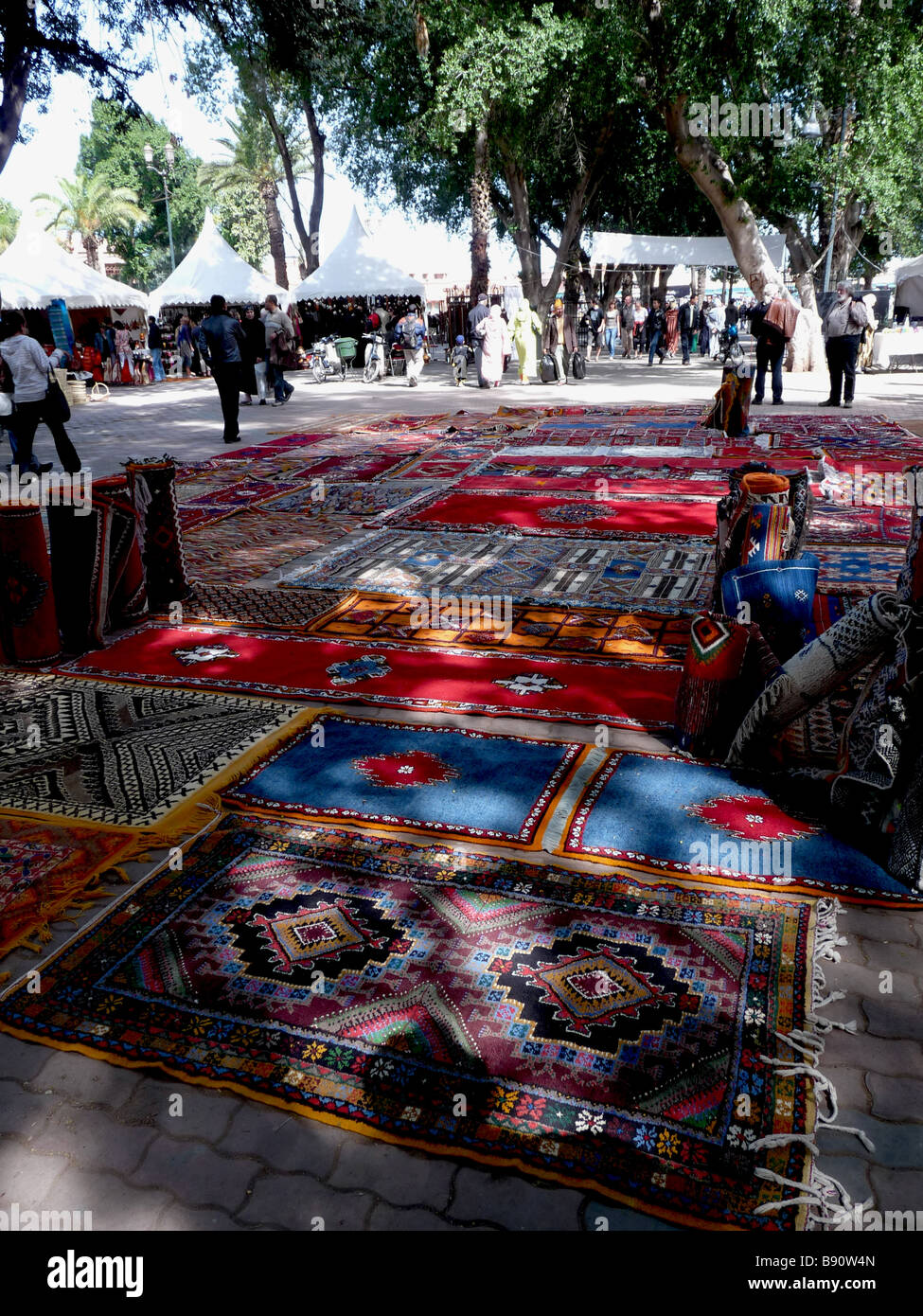 Berber and Arab rugs are displayed in an artisans market in Djma el Fna, the main square of Marrakech, Morocco. - Stock Image