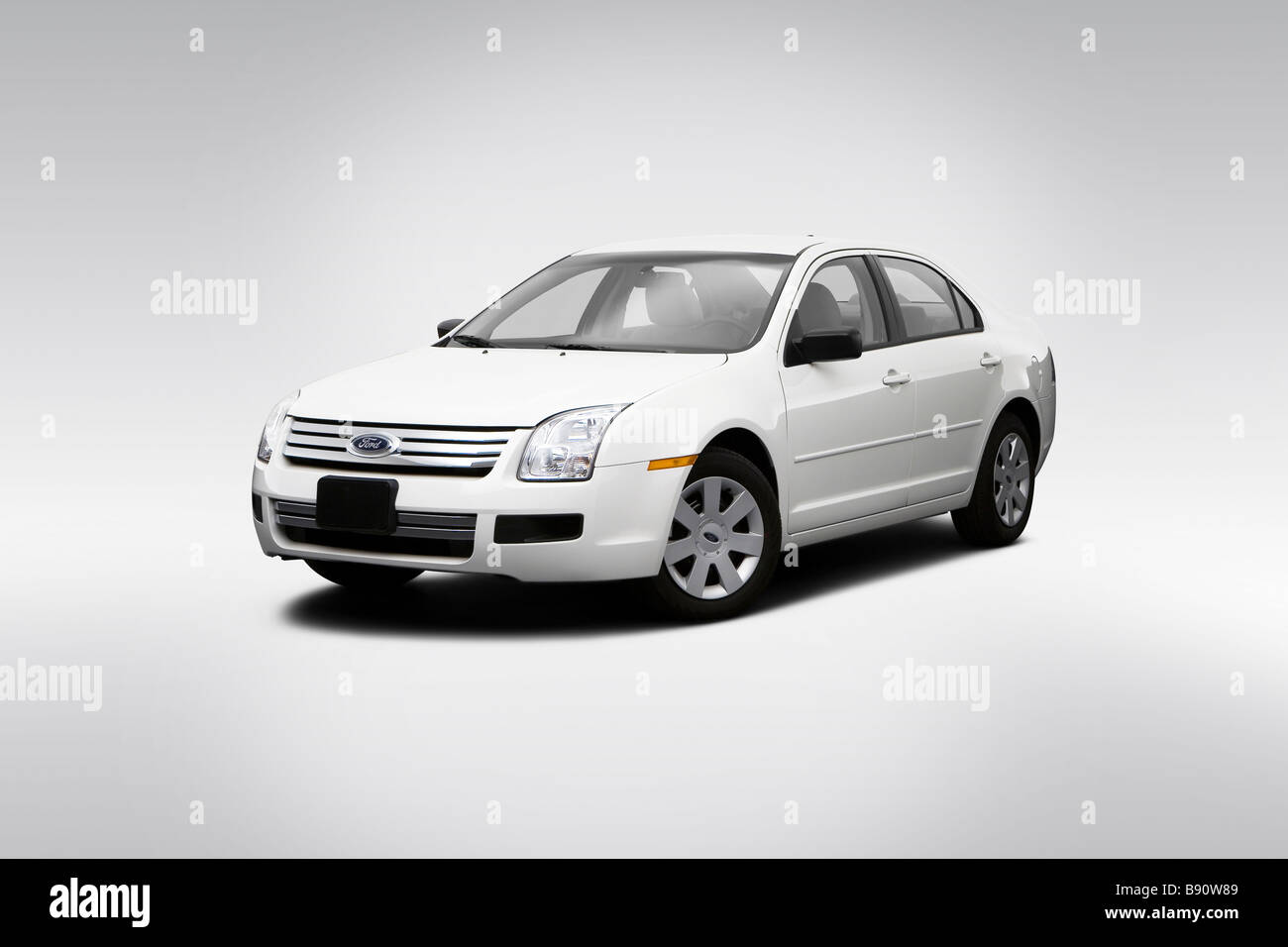 2009 Ford Fusion S in White - Front angle view - Stock Image
