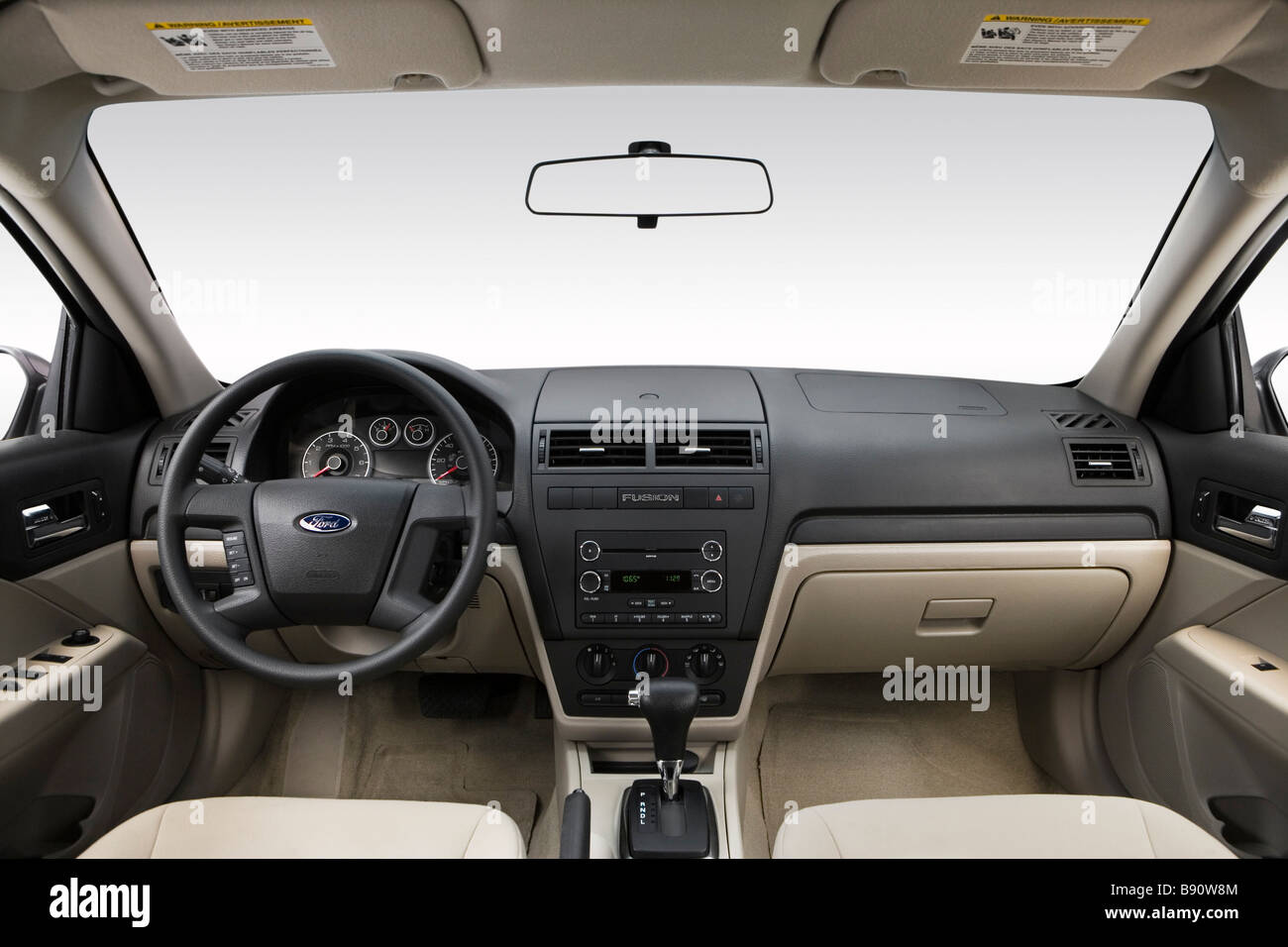 2009 Ford Fusion S in White - Dashboard, center console, gear shifter view - Stock Image
