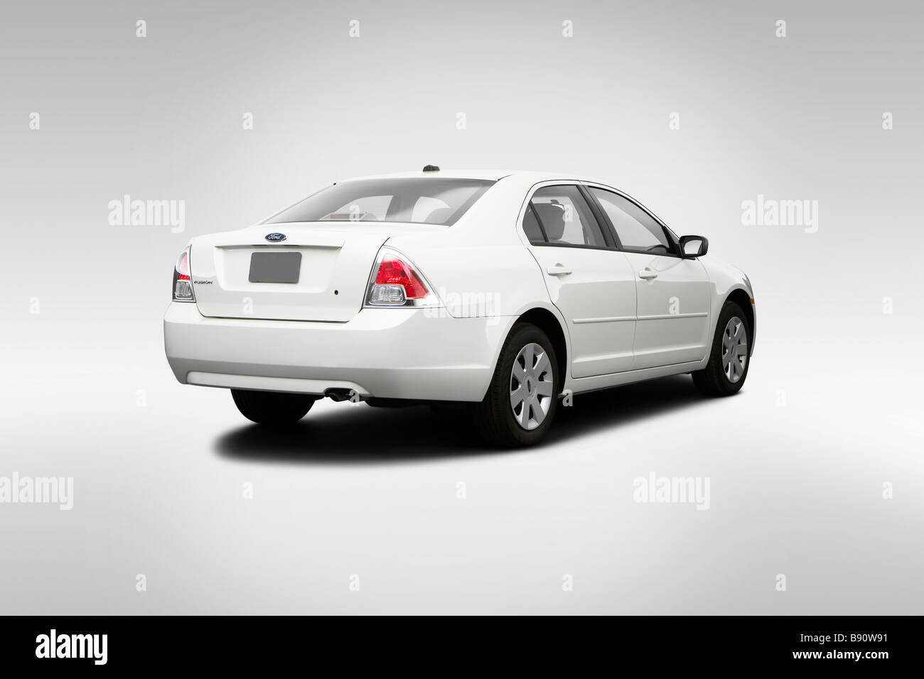 2009 Ford Fusion S in White - Rear angle view - Stock Image