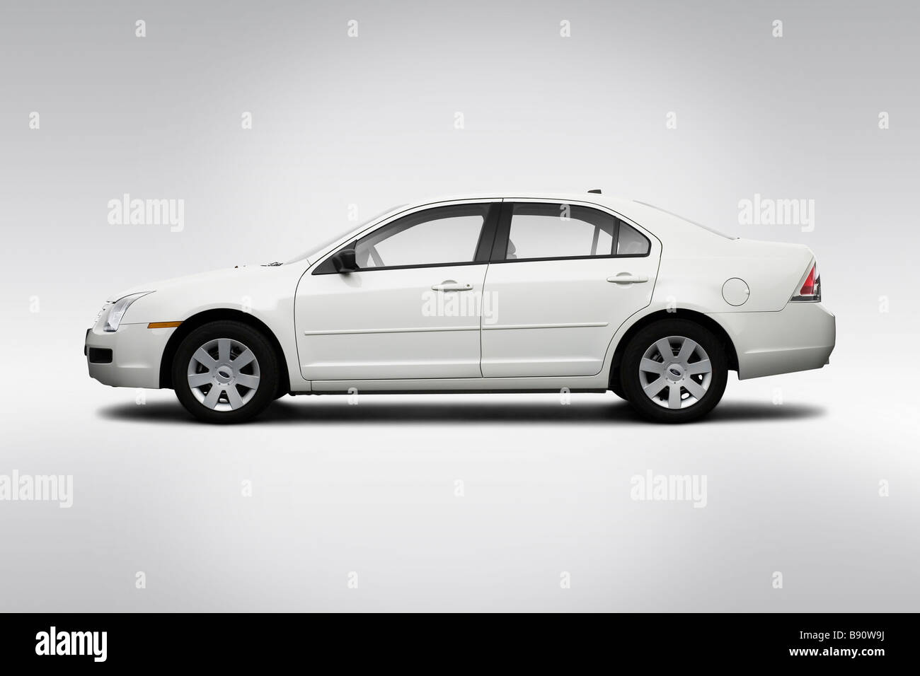 2009 Ford Fusion S in White - Drivers Side Profile Stock Photo
