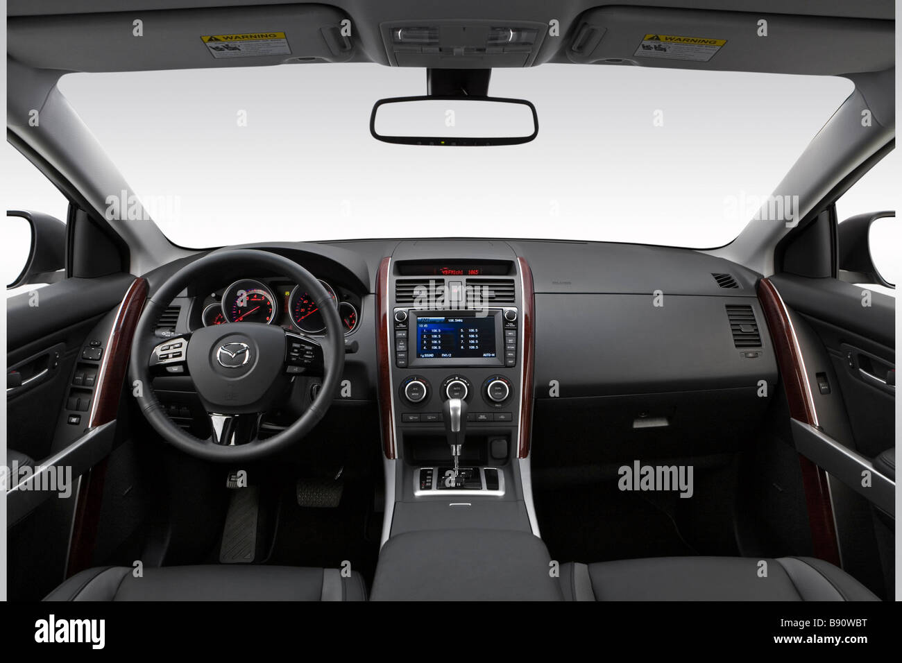 https://c8.alamy.com/comp/B90WBT/2009-mazda-cx-9-grand-touring-in-silver-front-angle-view-B90WBT.jpg