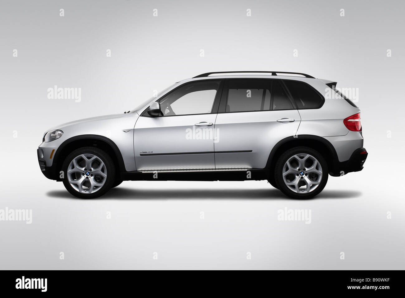 2009 BMW X5 4.8i in Silver - Drivers Side Profile - Stock Image