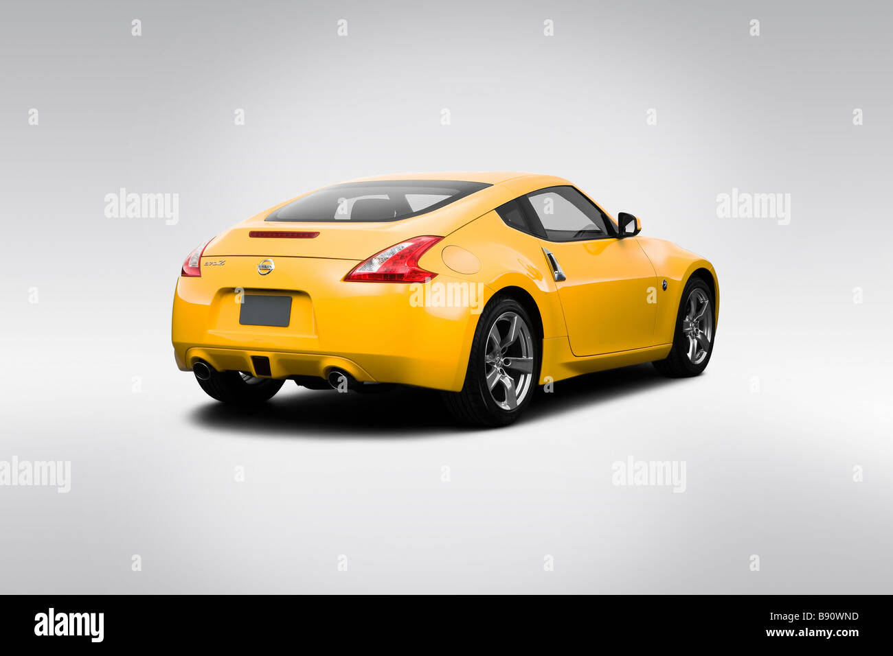 2009 Nissan 370Z In Yellow   Rear Angle View   Stock Image