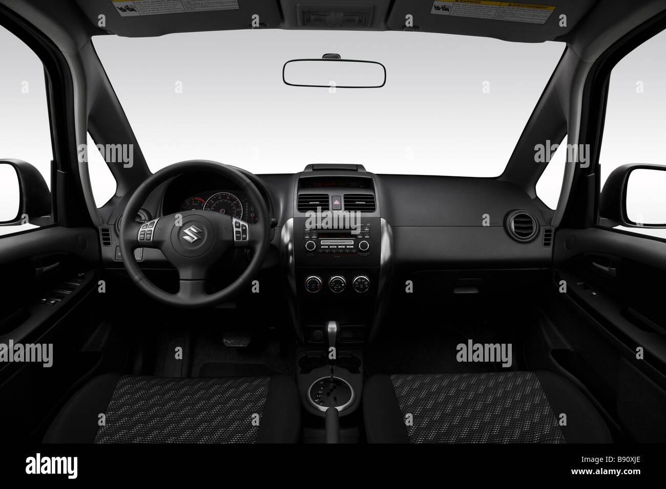 2009 Suzuki SX4 Crossover in Silver - Dashboard, center console, gear shifter view - Stock Image