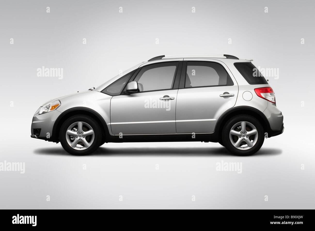 2009 Suzuki SX4 Crossover in Silver - Drivers Side Profile - Stock Image