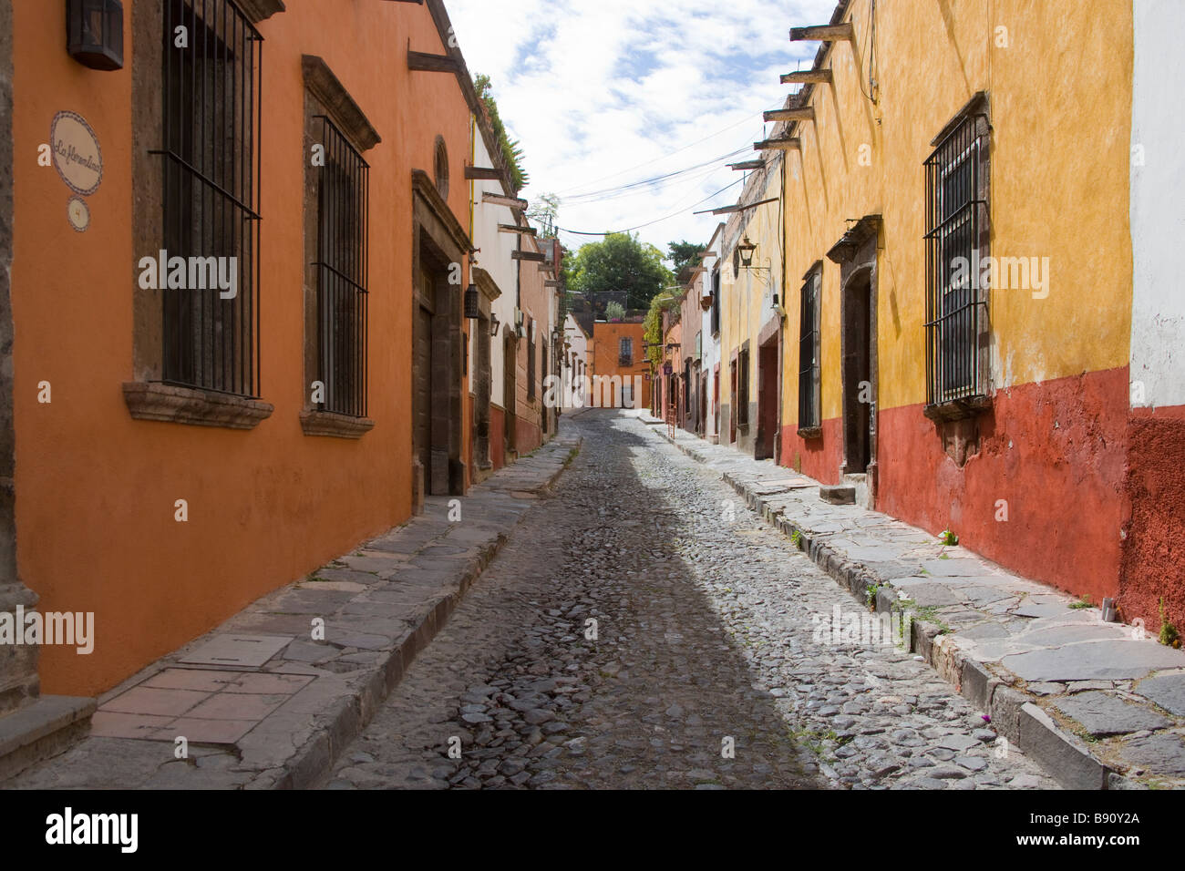 Colorful Cobblestoned  Street in San Miguel de Allende, Mexico - Stock Image